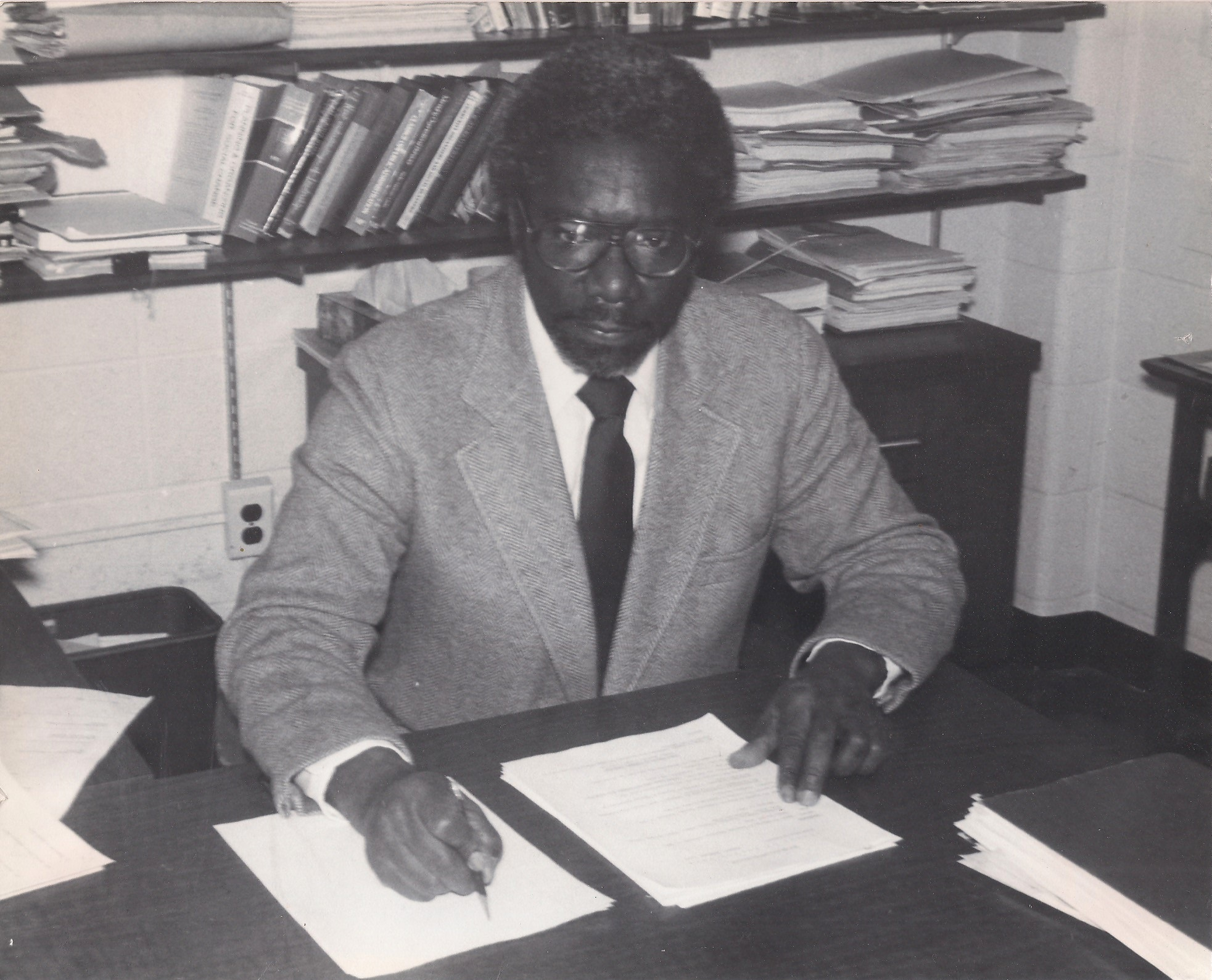 William Iverson Jr sitting at a desk in the WSU School of Social Work
